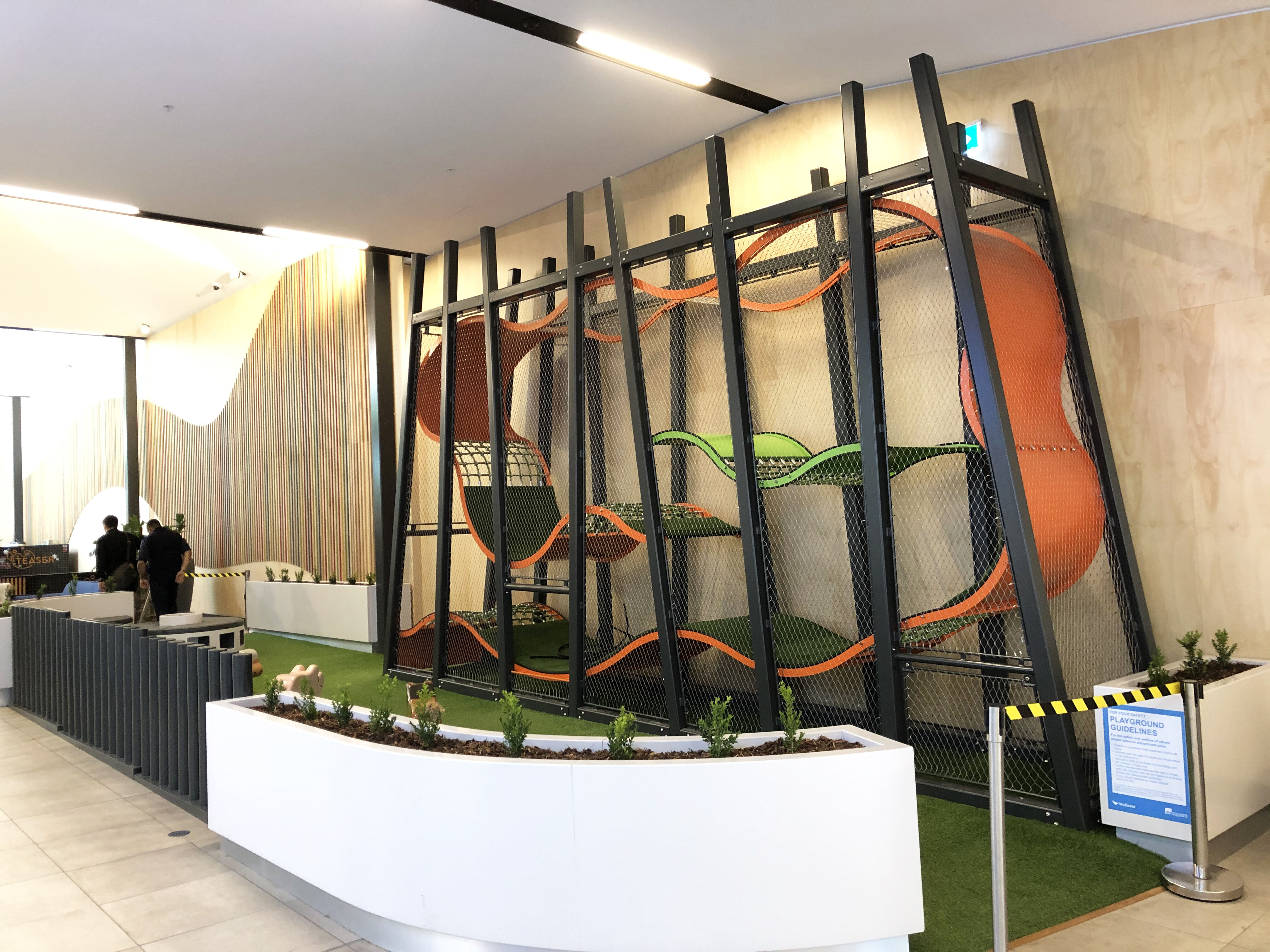 Indoor playground wave platform tower