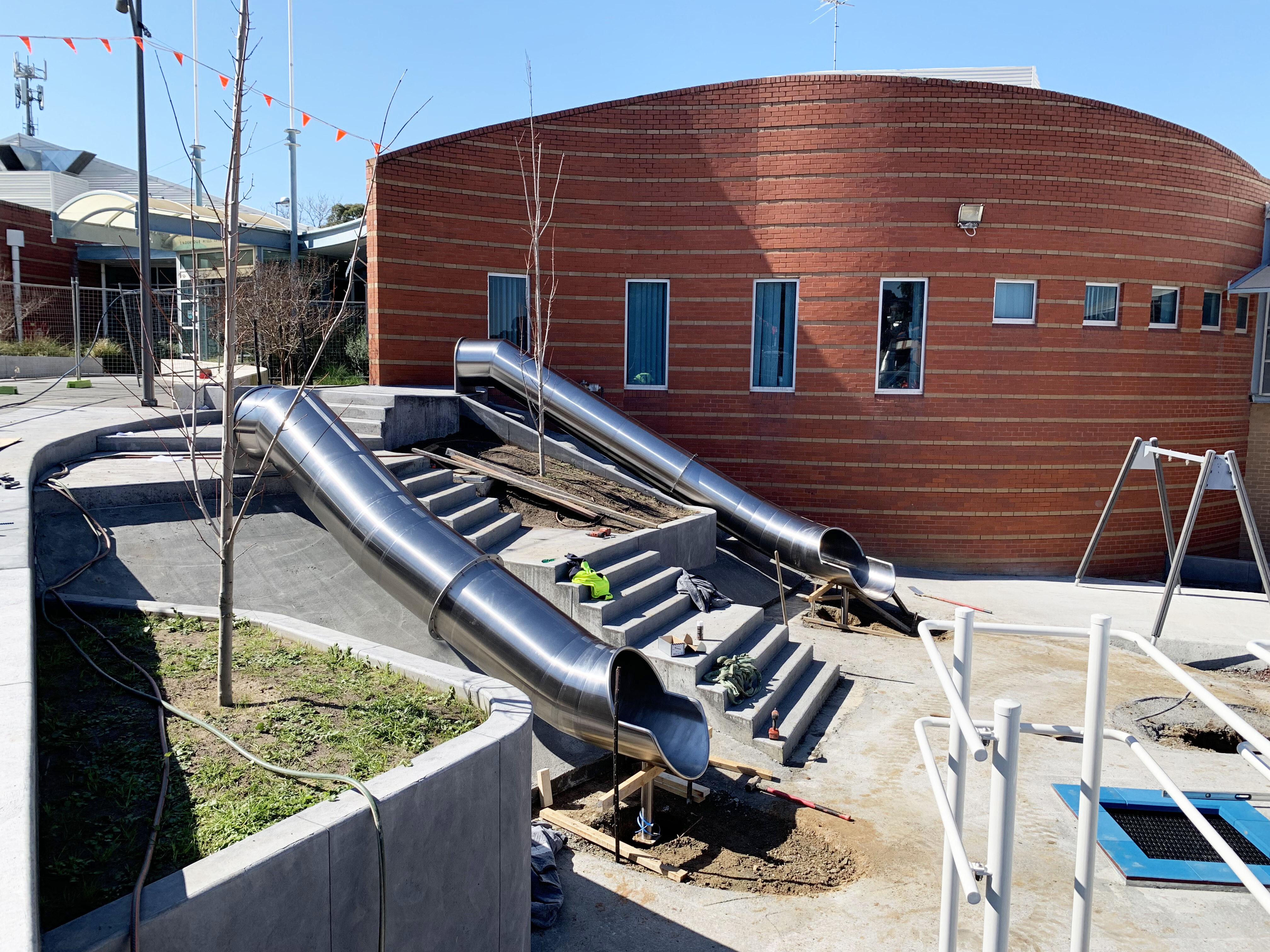 Playground with 2 stainless steel tube slides